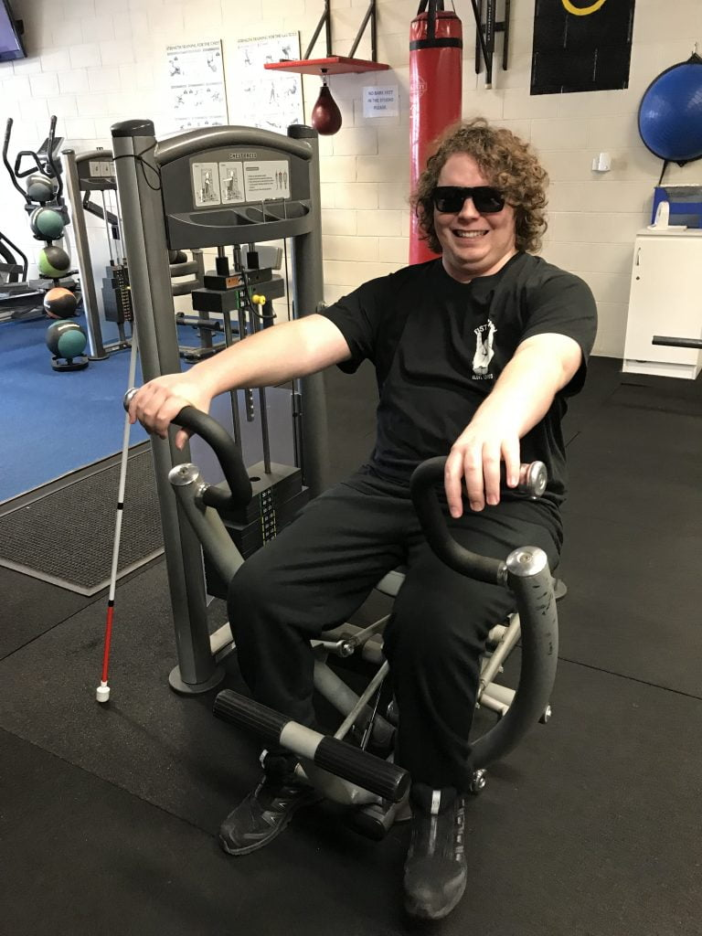 Image of a man working out in the gym