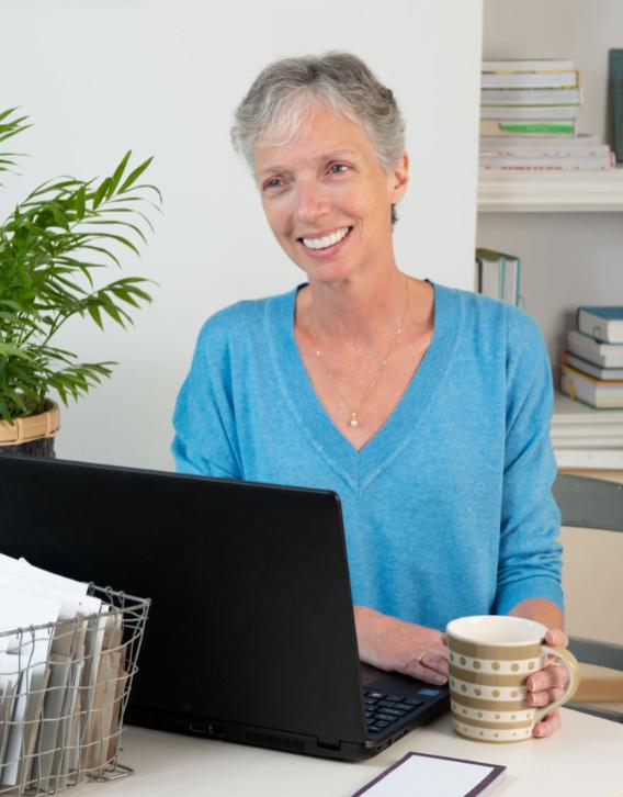 Elizabeth Barnes sits in front of computer