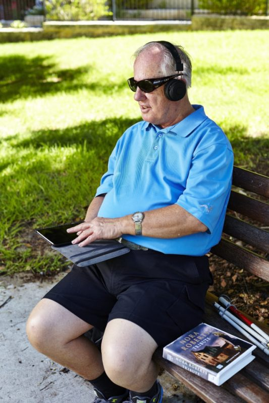 A client listening to a talking book on his iPad