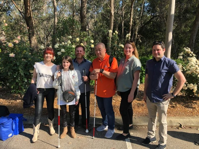 Participants who took part in the video smile standing on a footpath in Araluen Botanic Gardens