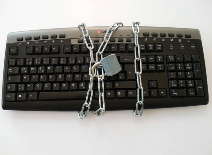 Keyboard with a lock and chain around it symbolising lack of accessibility.