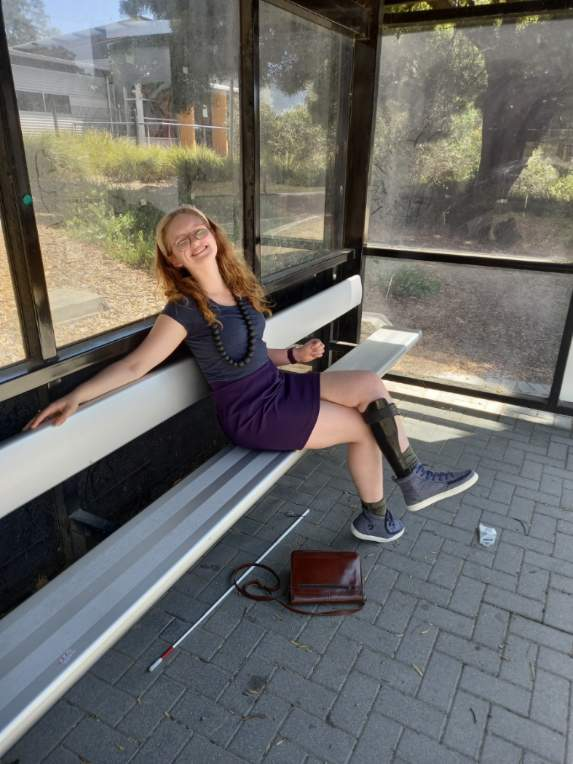 Girl sitting at the bus stop